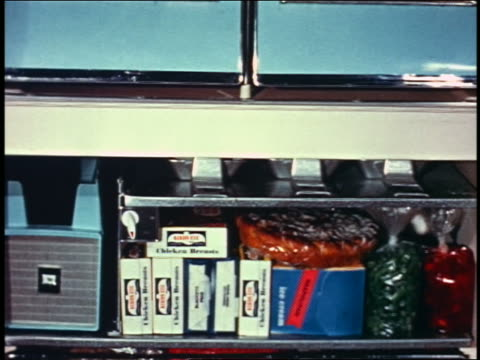 1958 tilt down close up open freezer filled with food - frozen food stock videos & royalty-free footage