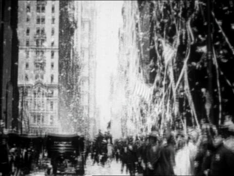 view tilt down confetti falling in ticker tape parade for charles lindbergh / newsreel - 1927 stock videos & royalty-free footage
