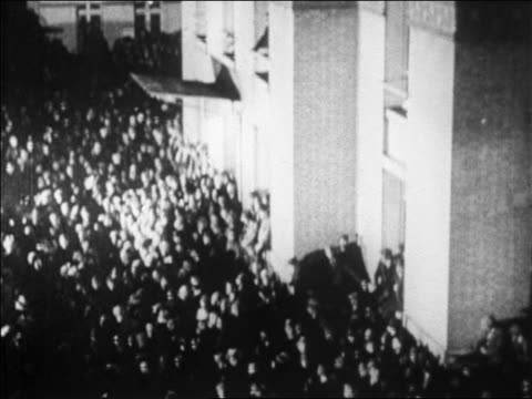 b/w 1927 tilt down crowd outside of le bourget airfield in paris to greet lindbergh / newsreel - 1927 stock videos & royalty-free footage