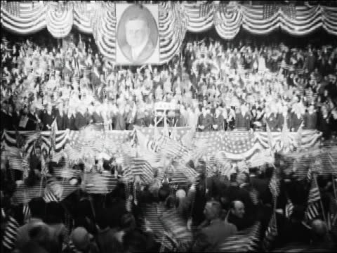 tilt down crowd waving flags at republican national convention / kansas city / news. - 1928 stock videos & royalty-free footage
