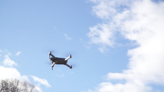 tilt down, drone lands in new york city park - drone stock videos & royalty-free footage