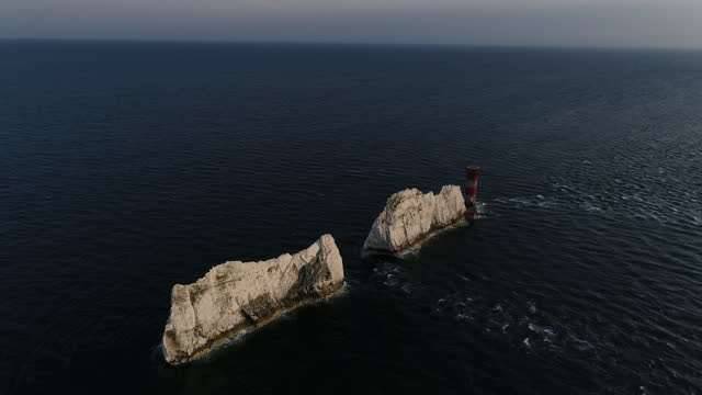 tilt down drone shot showing the needles lighthouse, isle of wight, united kingdom - tilt down stock videos & royalty-free footage