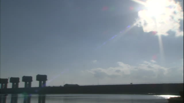 tilt down from blazing sun to the tidal gates in isahaya bay - polder stock videos and b-roll footage