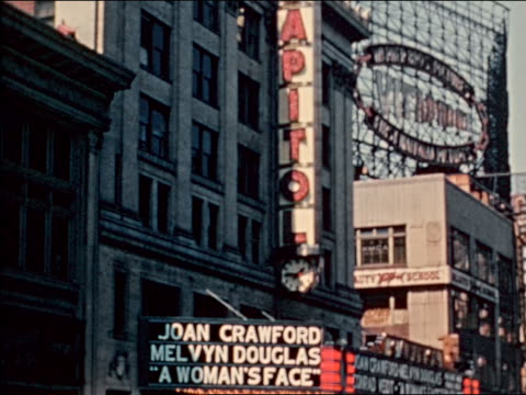 """1941 tilt down from capitol sign to marquee of theater showing """"a woman's face"""" / industrial - face down stock videos & royalty-free footage"""