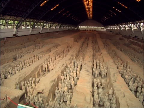 tilt down from ceiling to wa terracotta army, museum of qin, xian, china - tilt down stock videos & royalty-free footage