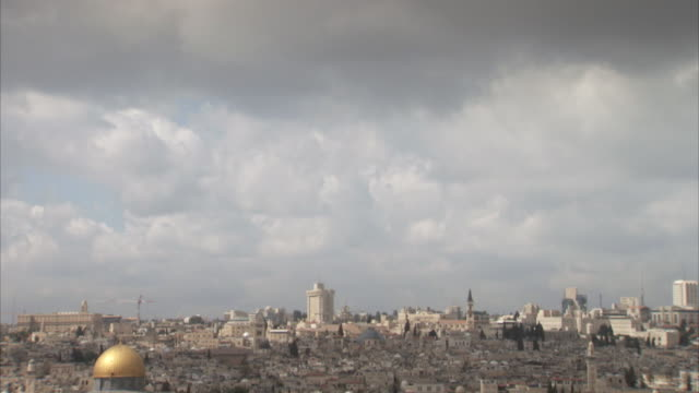 tilt down from clouds onto the dome of the rock and walls of jerusalem. - palestinian territories stock videos and b-roll footage