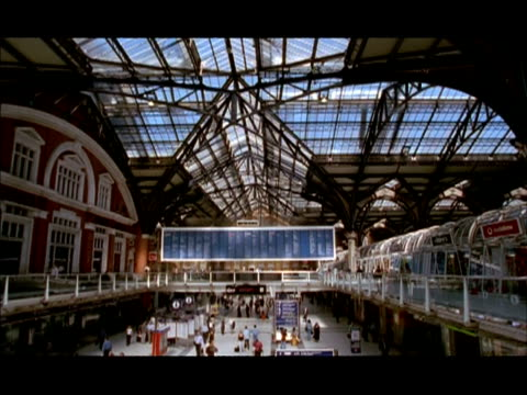 WA Tilt down from glass roof to Concourse of Liverpool Street Station, London, England