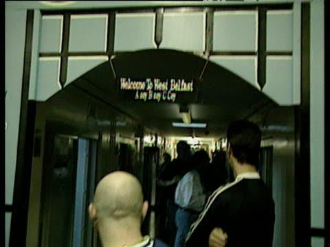 tilt down from loyalist symbols on wall to prisoners in corridor of maze prison belfast 08 jan 98 - loyalty stock videos & royalty-free footage