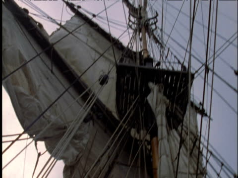 tilt down from masts and rigging to sailors hauling on sail lines on tall ship liverpool - sail stock videos & royalty-free footage
