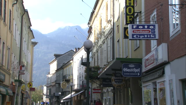 tilt down from mountains to traffic in narrow street, bad ischl, austria - austrian culture stock videos & royalty-free footage