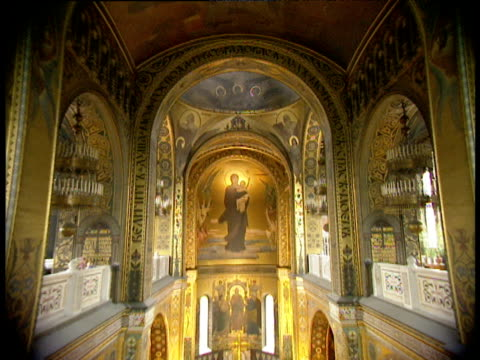 tilt down from ornate ceiling and fresco of madonna and child above altar in russian orthodox church - christianity stock videos & royalty-free footage