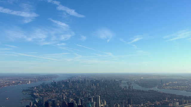 stockvideo's en b-roll-footage met tilt down from sky to island of manhattan in new york city, new york, usa. - tilt down