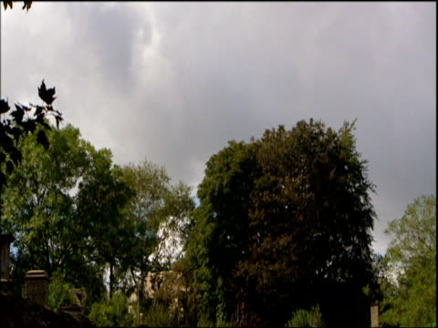 tilt down from sky to stone cottages cotswolds - cotswolds stock videos & royalty-free footage