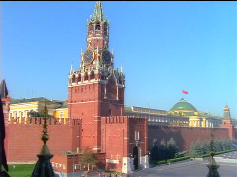tilt down pan from spassky tower of kremlin to red square / moscow - moscow russia stock videos & royalty-free footage