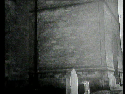 tilt down from spires of st martin's church in bladon to winston churchill's open grave uk 1965 - place concerning death stock videos and b-roll footage