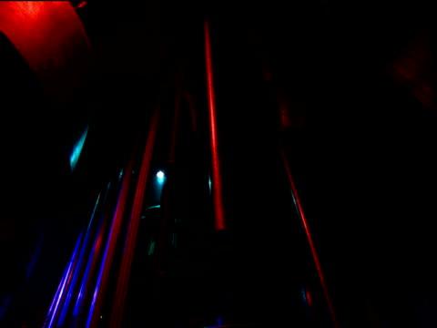 vídeos de stock, filmes e b-roll de tilt down from suspended tubular bells to people attending avant-garde music performance moscow - pouca luz
