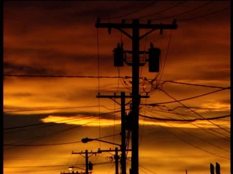tilt down from telegraph poles to street at sunset kotzebue alaska - telegraph stock videos & royalty-free footage