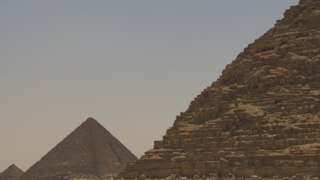 Tilt down from the large Pyramid of Khafre to other pyramids, Giza, Egypt.