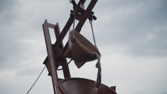 Tilt down from the smelting vats in the tribute to labor sculpture along the Missouri River, titled 'Labor' by Matthew Placeck.