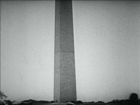 b/w 1932 tilt down from top of washington monument to wwi veterans walking in bonus march - 1932 stock videos & royalty-free footage