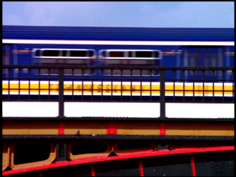 tilt down from train crossing blackfriars railway bridge to traffic and pedestrian on blackfriars bridge, london - railway bridge stock videos & royalty-free footage