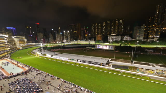 tl tilt down hong kong happy valley horse race course at night. - spoonfilm stock-videos und b-roll-filmmaterial