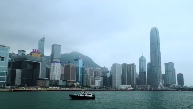 tilt down: hong kong landscape at waterfront in cloudy sky. - tilt down stock videos & royalty-free footage