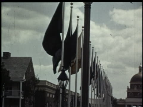1939 tilt down pan horse dragon statue rows of flags buildings / avenue of states / ny world's fair - esposizione universale di new york video stock e b–roll