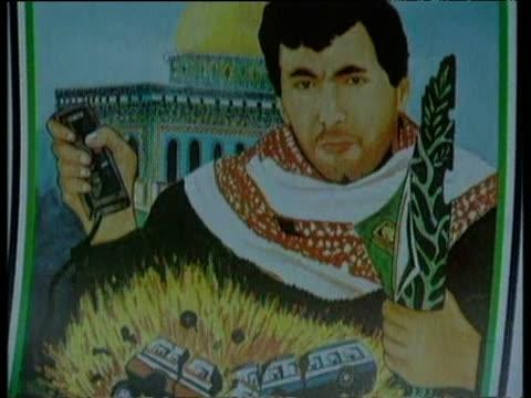 tilt down image of celebrated hammas bomber yahya ayyash depicting his crime gaza march 1996 - gaza strip stock videos & royalty-free footage