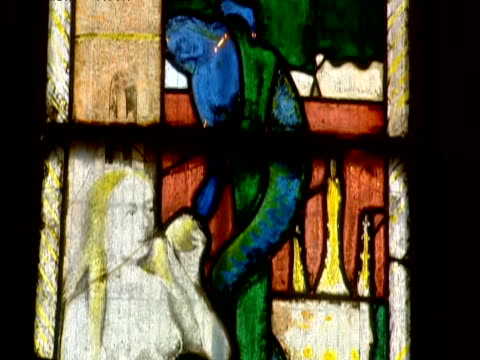 tilt down image of eve in stained glass window - biblical event stock videos & royalty-free footage