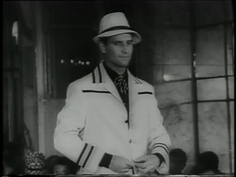 B/W 1961 tilt down man in hat trimmed white suit on runway in Italian fashion show