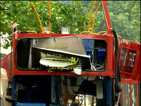 Tilt down mangled front of bus aftermath of 2005 London bombings Tavistock Square; 12 Jul 05