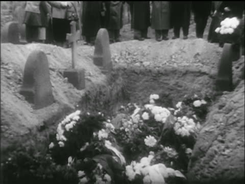 b/w 1956 tilt down mass grave site filled with flowers / hungarian uprising - 1956 stock videos and b-roll footage