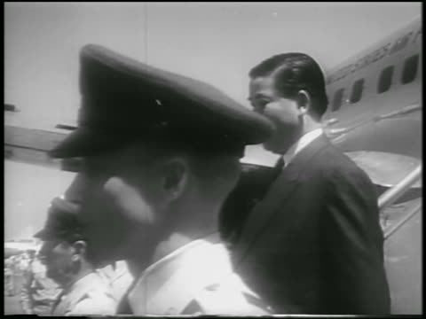 tilt down ngo dinh diem walking down airplane stairs + shaking hands with eisenhower - 1957 stock videos & royalty-free footage
