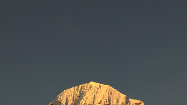 tilt down north face mount kailash reflecting sunlight lhasa tibet - tibet stock videos & royalty-free footage
