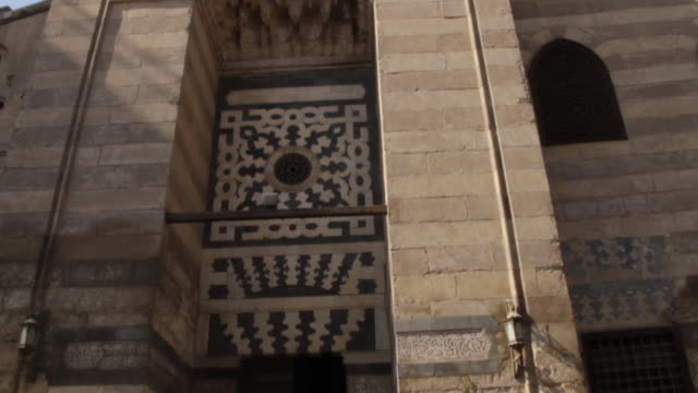 tilt down of a building in coptic cairo exterior - babylon stock videos and b-roll footage