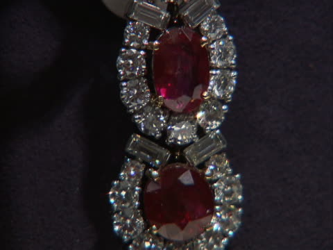 tilt down of a ruby and diamond earring owned by actor and philanthropist elizabeth taylor. these jewels were part of a four-day charity auction of... - auction stock videos & royalty-free footage