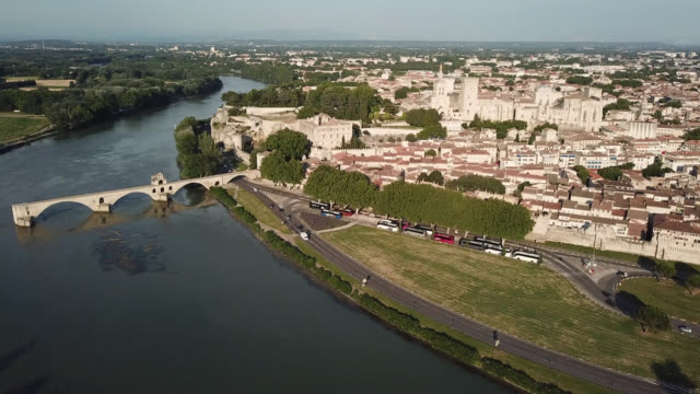tilt down of avignon bridge and palace of the popes, seen from drone - rhone river stock videos & royalty-free footage