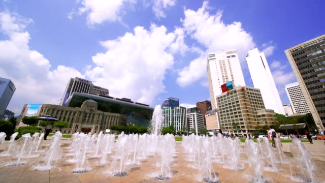 Tilt down of Fountains in front Seoul City Hall in Seoul Plaza,Korea. The building was constructed by the Japanese occupation government in 1926.