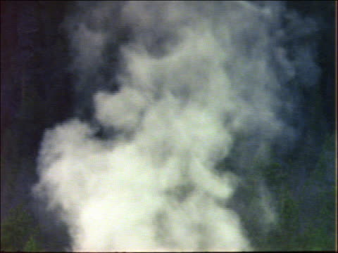 tilt down of steam rising from geyser - geology stock videos and b-roll footage