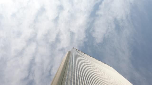 4k tilt down office building and sky - tilt down stock videos & royalty-free footage