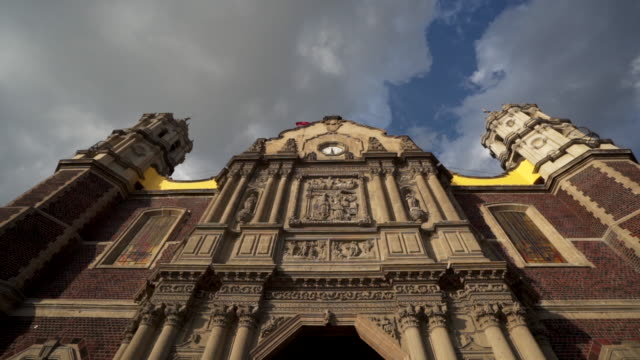 tilt down, old basilica of our lady guadalupe in mexico - basilica stock videos and b-roll footage