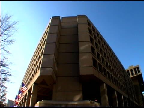 Tilt down on J Edgar Hoover FBI Building, Washington DC