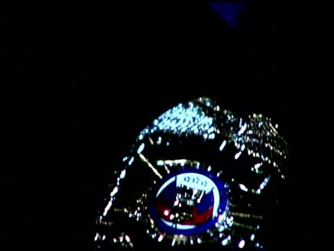 Tilt down on policeman's badge