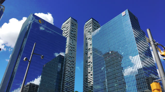 vídeos de stock, filmes e b-roll de tilt down on the sunlife financial and royal bank skyscrapers in the waterfront area on june 30 in toronto, ontario, canada. this area, located... - ponto turístico local