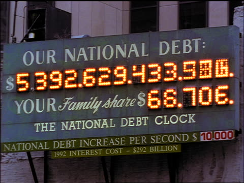 tilt down Our National Debt sign / New York City