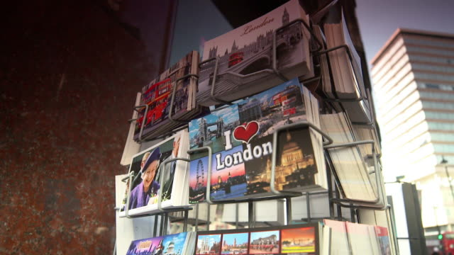 tilt down over a rack of london postcards in london, england - postcard stock videos & royalty-free footage