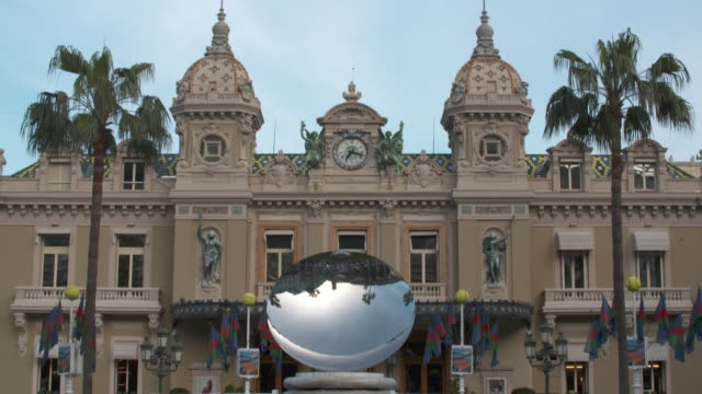 tilt down over casino de monte-carlo to reveal the mirror sculpture 'sky mirror' by anish kapoor - mirror stock videos & royalty-free footage