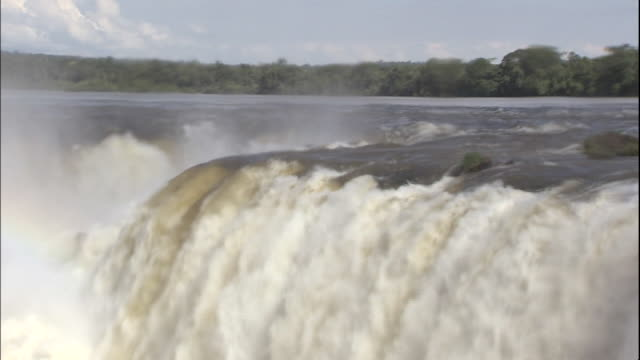 tilt down over devil's throat section of iguazu falls, border of brazil and argentina - devil's throat stock videos and b-roll footage