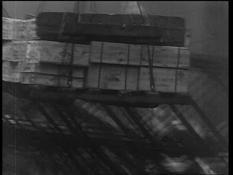B/W 1933 tilt down pallet of crates being lowered on rope from large ship / end of Prohibition